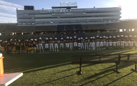 SW Football Team Lines Up For the National Anthem