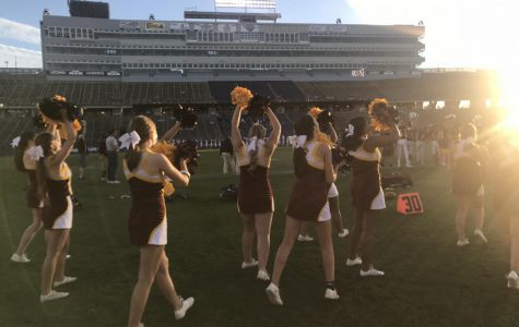 W Cheer Team Supports Football at Rentschler Game