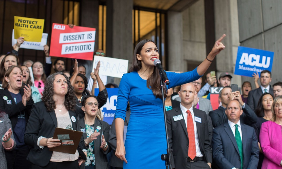 Caption: Alexandria Ocasio-Cortez campaigns in New York in 2018