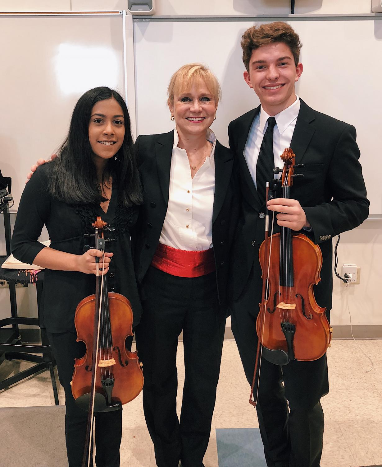 Former student Sai Manasani, conductor Ms. Burns, and Gabe Galley at NEMFA last year.