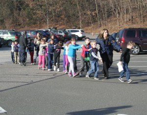 Students of Sandy Hook Elementary evacuate on the anniversary of the horrible shooting.