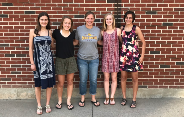 Left to right: Marlena Klein, Anna Armstrong, Coach Flaschbart, Jessica Polito, and Sonali Chokshi pose for a picture at the end-of-the-year banquet last year