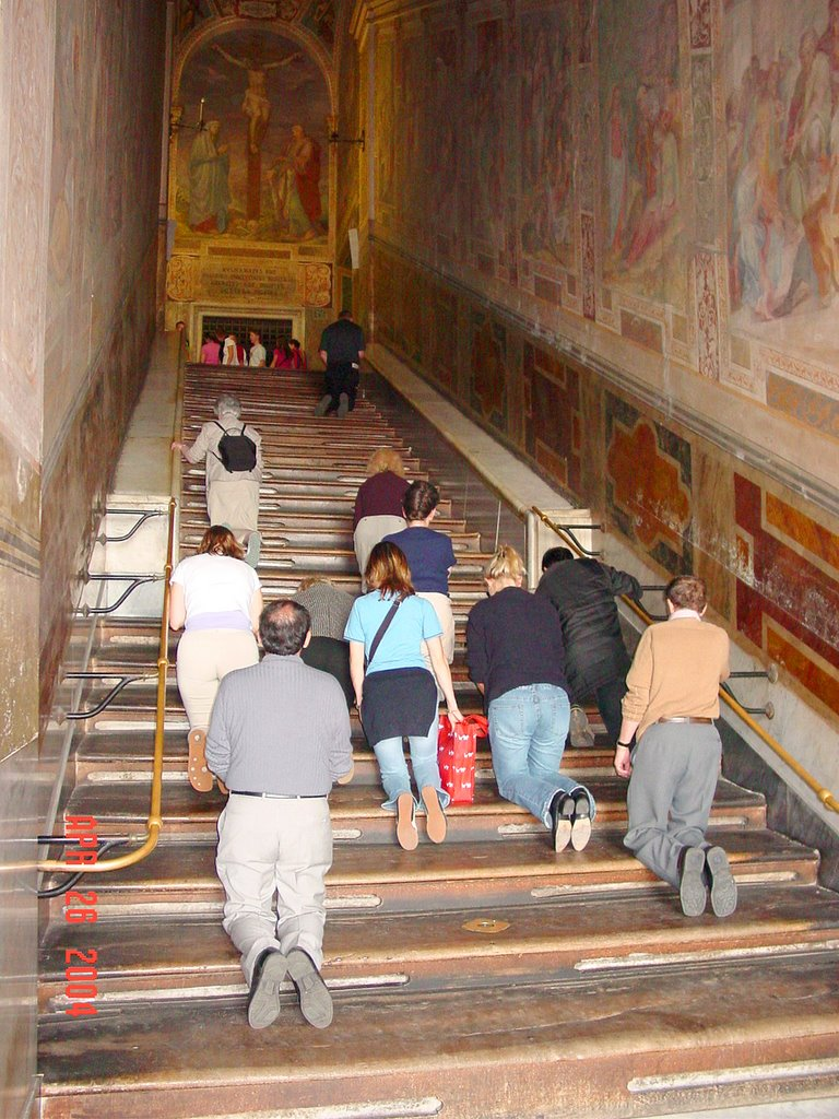 Scala Santa Sacred Stairs-Rome,italy. Visitors kneel on the Holy Stairs in Rome, which are currently uncovered for the first time in over 300 years.