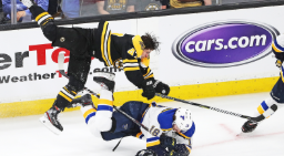 D Torey Krug (top) delivers a huge hit to C Robert Thomas during Game 1 of the Stanley Cup Final