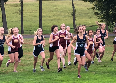 The Girls XC Team in action against East Catholic