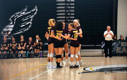 The Girls Volleyball team huddles up after a point at Enfield High School