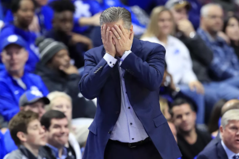 Kentucky coach John Calipari hiding his face during an embarrassing upset loss against Evansville Source: Chicago Sun-Times