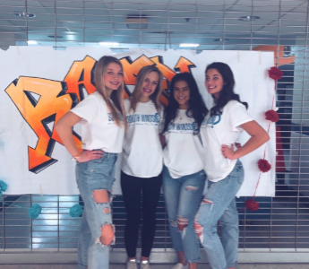 Taryn Suffish, Mikayla Mansfield, Maliya Haddock and Ella Suppicich (from left to right) join other students at the annual dance marathon for a night fun and fundraising.