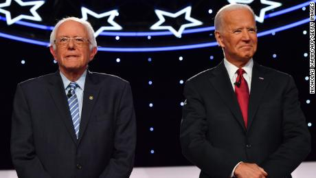 Democratic presidential hopefuls former US Vice President Joe Biden and Vermont Senator Bernie Sanders arrive onstage for the fourth Democratic primary debate of the 2020 presidential campaign season co-hosted by The New York Times and CNN at Otterbein University in Westerville, Ohio on October 15, 2019. (Photo by Nicholas Kamm / AFP) (Photo by NICHOLAS KAMM/AFP via Getty Images)