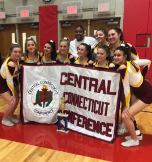 SW Cheerleaders pose with their first place trophy and CCC banner after taking 1st