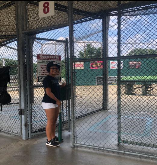 Heather Kim prepares to head into the batting cages and hit some softballs.